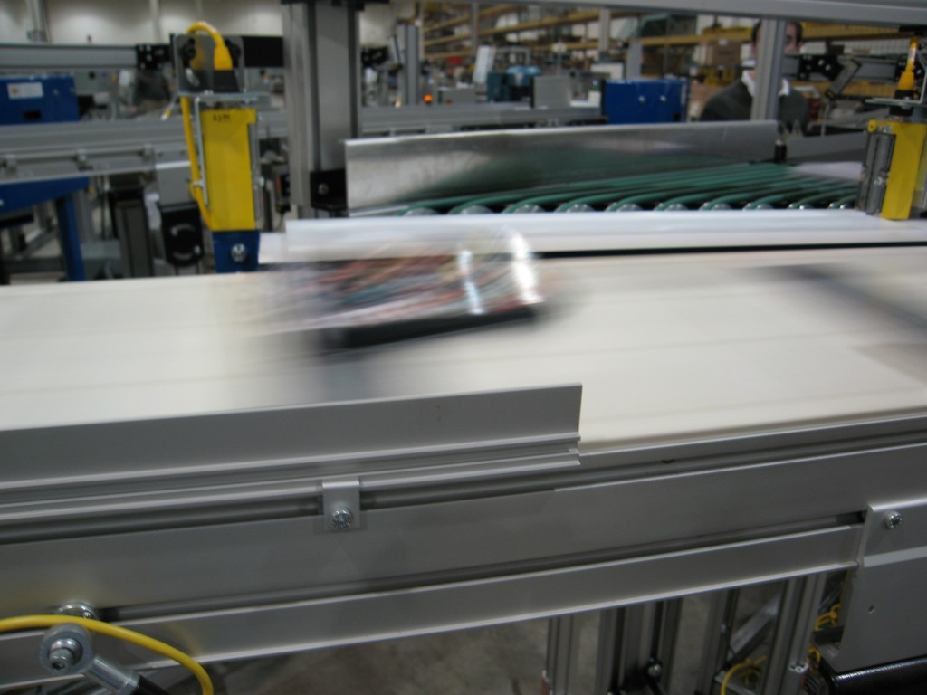 Product moving quickly across conveyor belt system