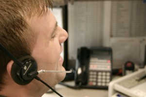 Person speaking on telephone headset